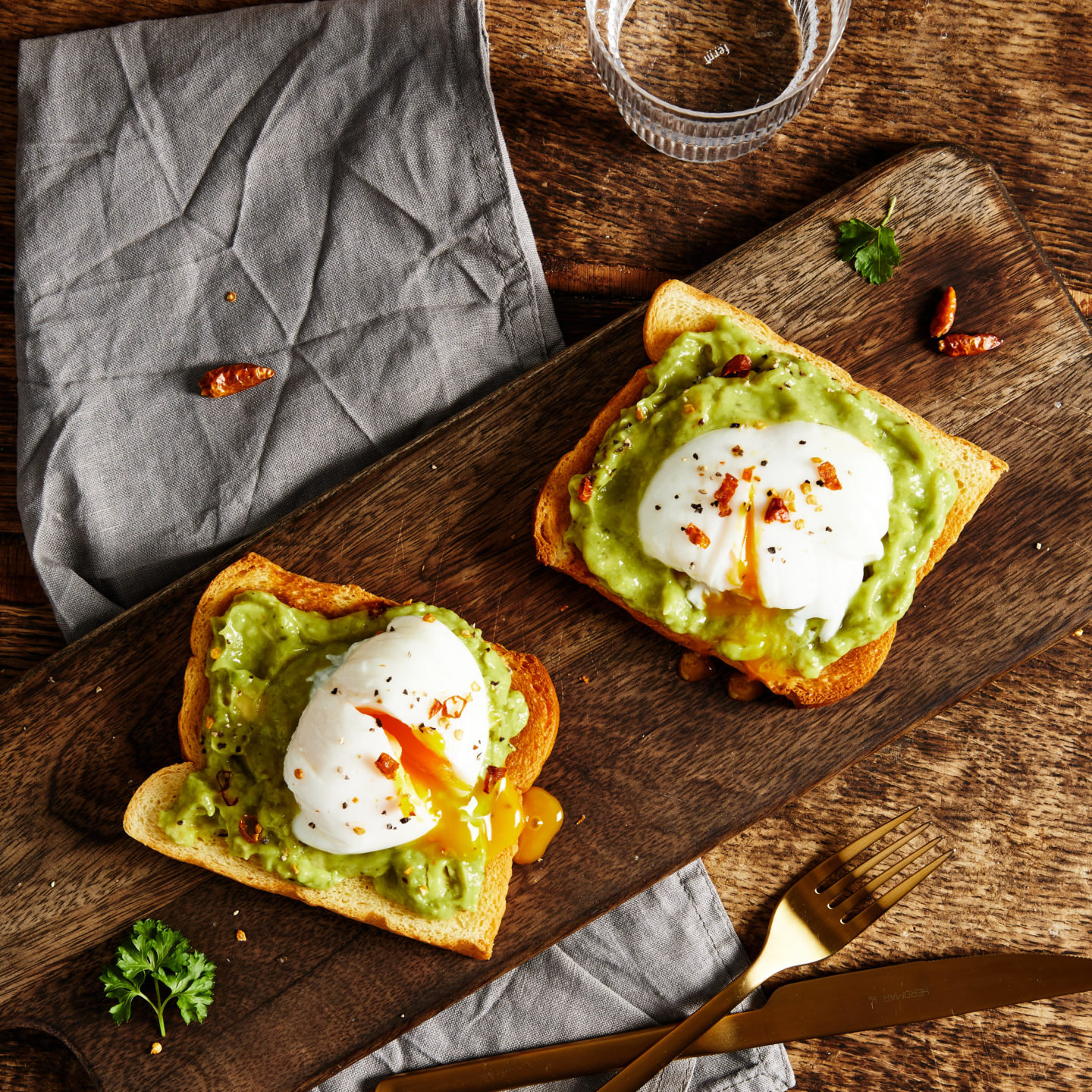 Jan-YOU-ary with St Pierre. An overhead shot of brioche toast with avocado and poached eggs on top.