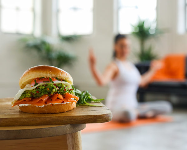 St Pierre Brioche Breakfast Burger With Woman Doing Yoga