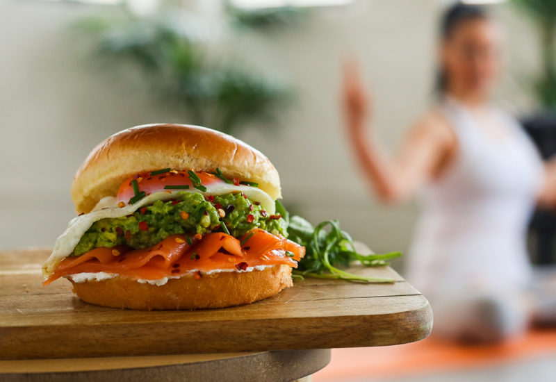 A photo of a Salmon and Cream Cheese Brioche Roll recipe on a wooden board