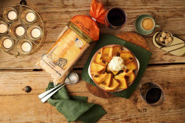 A table with a brioche dessert dish and brioche loaf